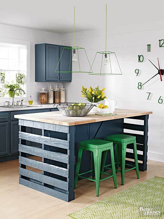 warehouse pallets and green metal stools are paired with vintage-inspired navy cabinets and butcherblock countertops