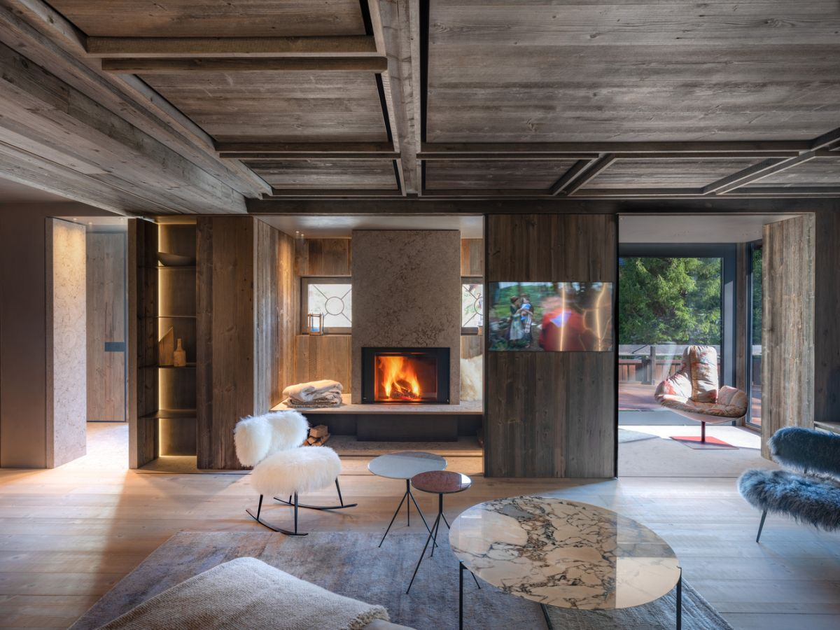 This gorgeous Italian home features a unique combo   minimalist design and 100 yesr old reclaimed wood infused into decor in order to give it a warm and cozy feel and character