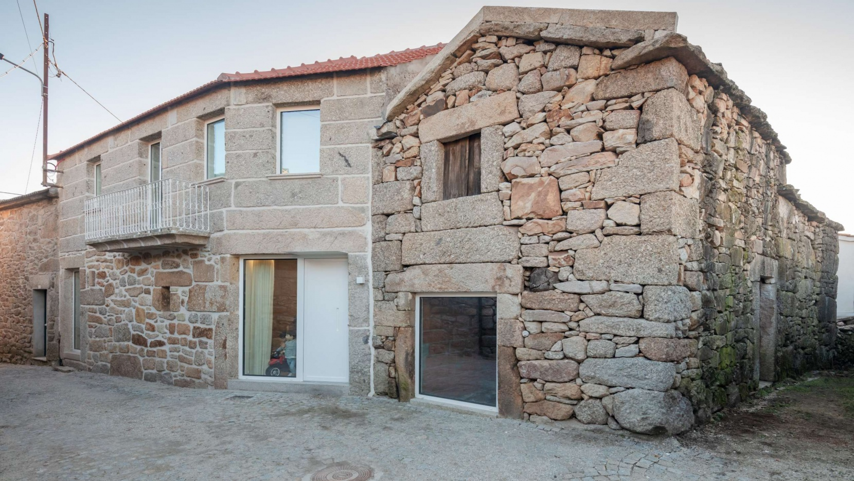 This house was originally built in 1940s of stone and nowadays it was restored and renovated for contemporary living