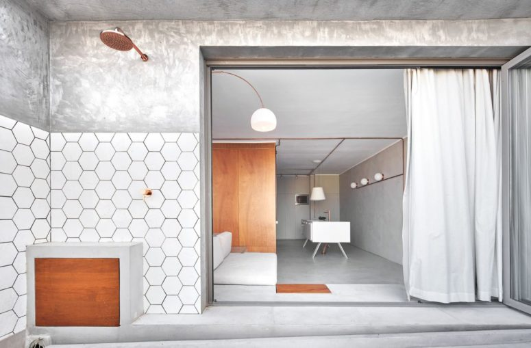 The designers chose minimalist style to get maximum of the space, added geometry and copper touches