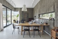 02 The dining or working space is done with black chairs and a wooden table