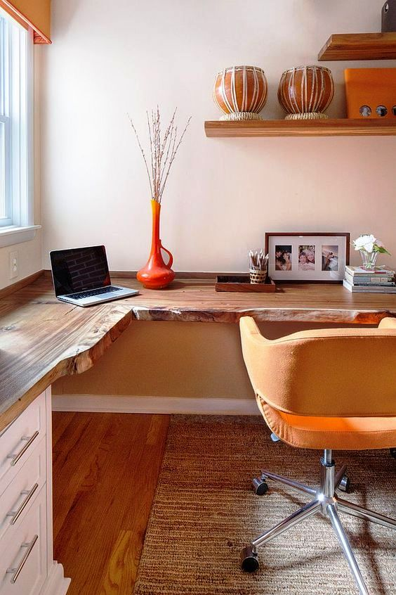 a live edge corner wooden desk with white drawers and mustard touches for a stylish mid-century modern home office