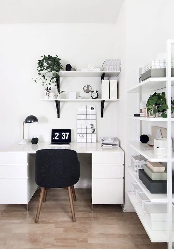 a monochromatic white home office done in Scandinavian style, with just touches of black for more eye-catchiness