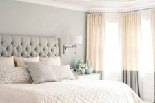 02 a soothing bedroom in light greys, with an upholstered bed, two tone curtains and an elegant bench