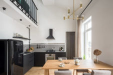 03 The dining space is furnished with a wooden table and grey upholstered chairs