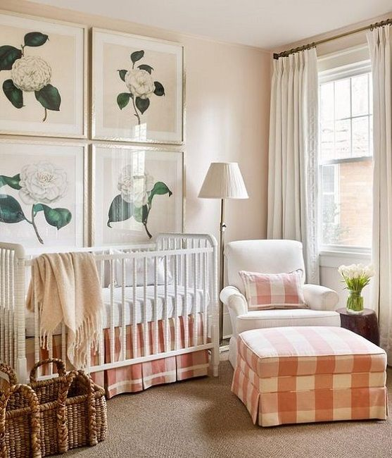 a cozy farmhouse nursery with peach and white plaid textiles and flower artworks may be nice for a girl's space