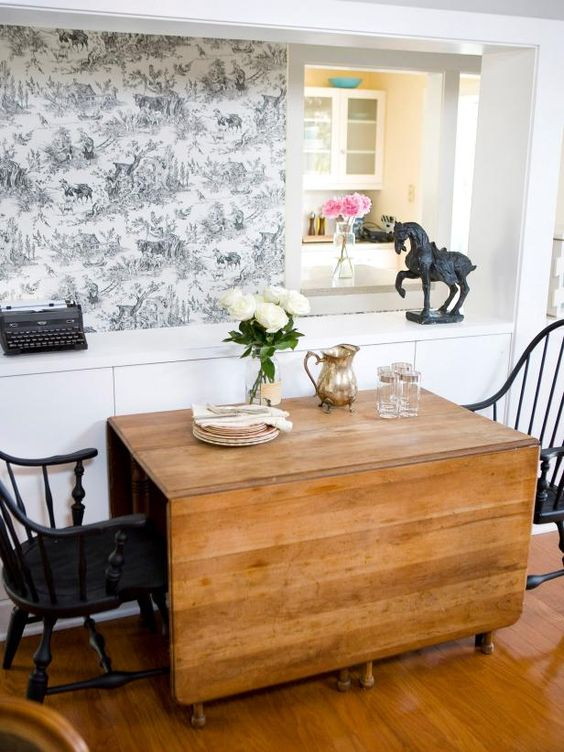 a traditional drop leaf dining table will save much space and add a cozy vintage touch to the room