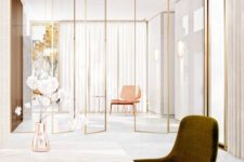 03 sheer glass screens with gold framing visually separate the spaces giving a slight glam feel to the space