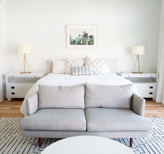 a dove grey modern loveseat doesn't stand out to much and matches the neutral and soothing bedroom decor