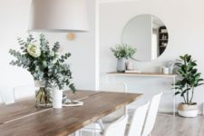 04 a neutral wooden dining table on white hairpin legs and matching white wicker chairs for an airy feeling