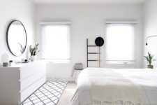 04 a pure white bedroom with a Nordic feel, a whiet sleek sideboard and shades on the windows