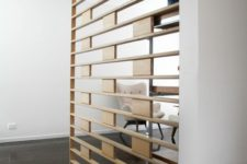 04 a sheer wooden screen is a cool way to separate the spaces with style and without any bulky looks