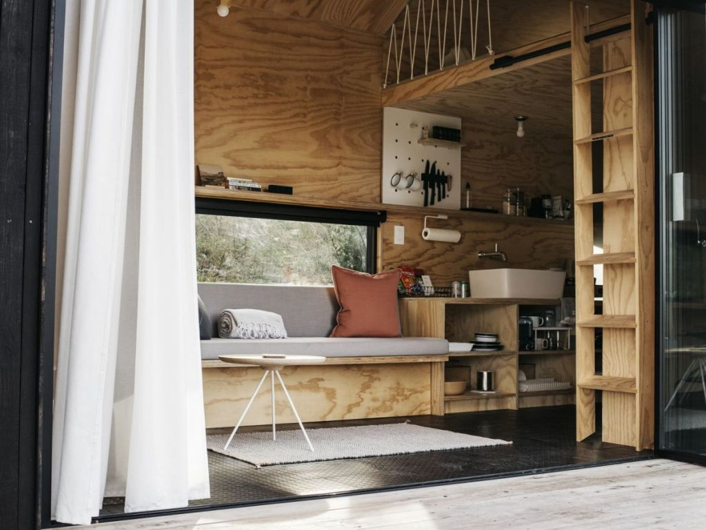The furniture is minimalist and built in, it's very functional, and the cabin itself is very small to inspire to spend more time outdoors