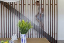 05 a sleek contemporary wooden screen perfectly finishes the space and separates the staircase from the rest of the home