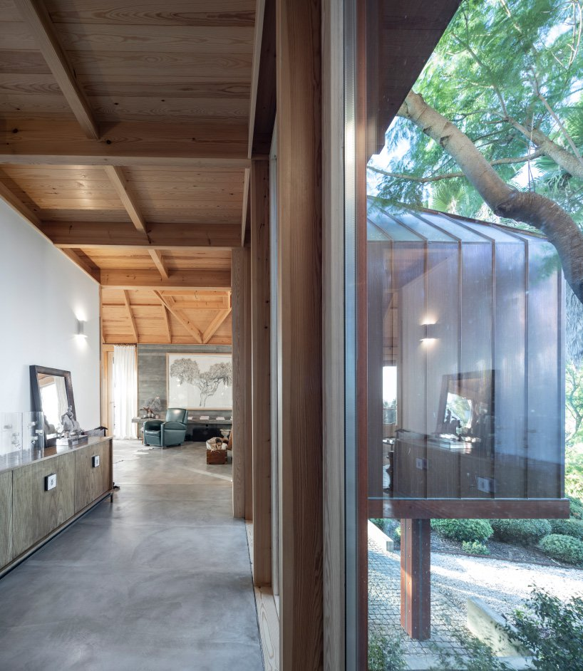 Glazed walls let much natural light in and make the spaces feel airy and cozy