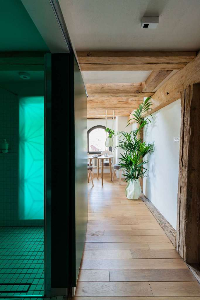 The bathroom is done in neutrals but the green lights all over make the space brighter and whimsier