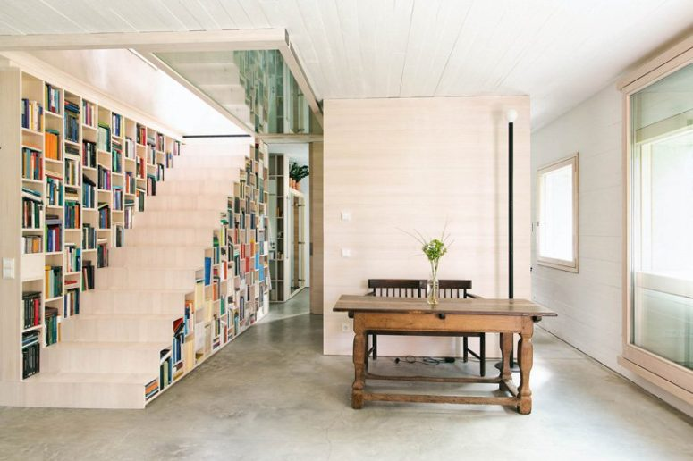 The staircase is also a bookcase, which makes the space more functional and the storage space isn't necessary