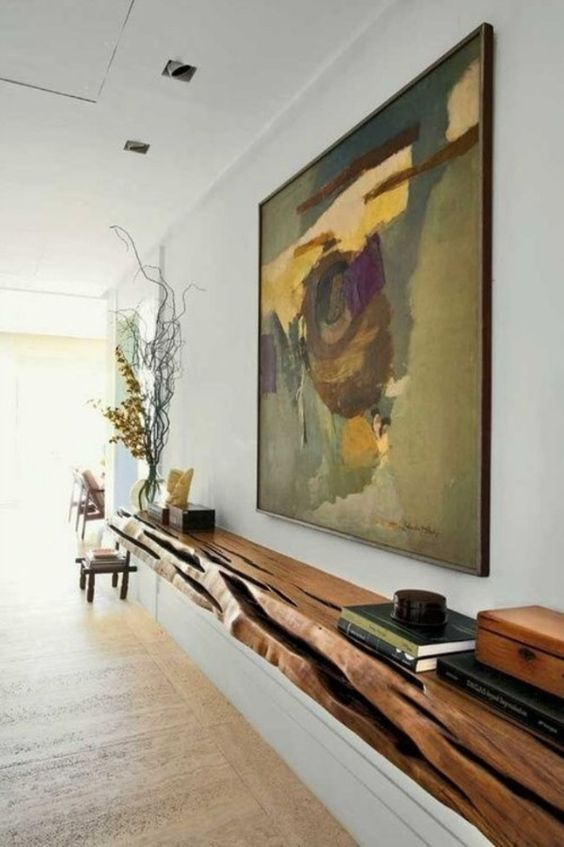 a floating console made of a single wooden slab with a live edge is a great statement in your interior