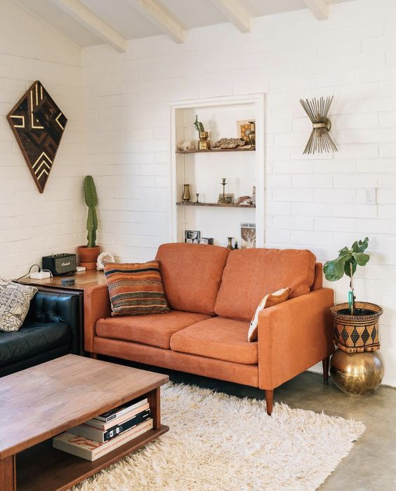 a lovely rust-colored loveseat for a mid-century modern living room and to add a touch of color