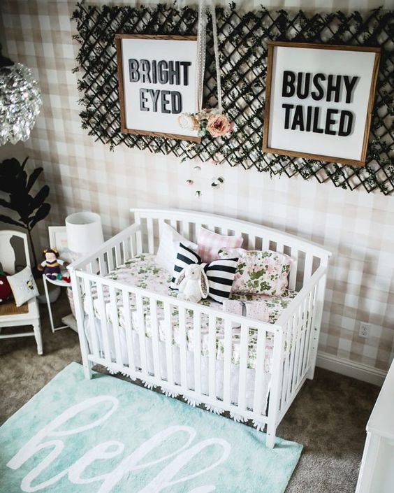 a plaid statement wall, stripes and floral prints will add a slight girlish touch to the nursery