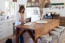 06 a rustic wooden drop leaf dining table, wooden lampshades that match and metal stools