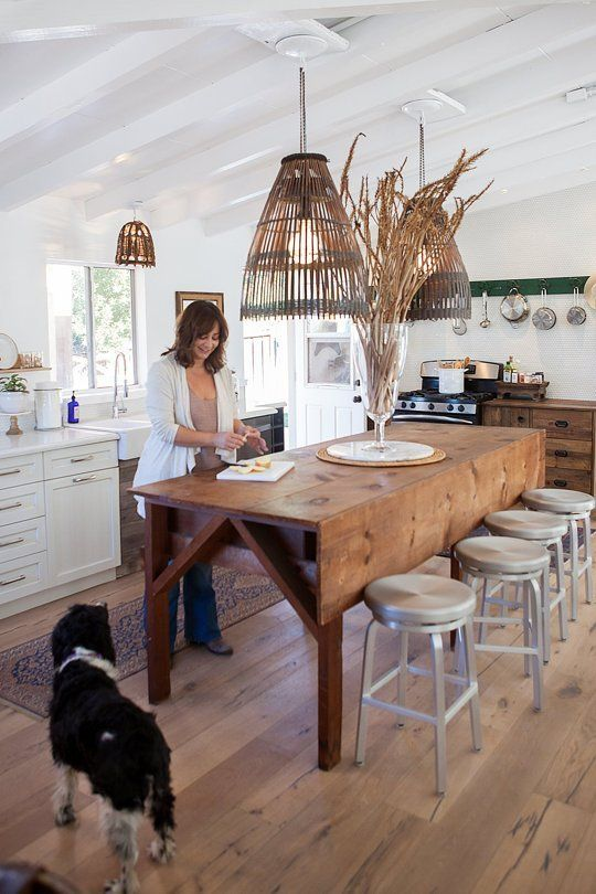 a rustic wooden drop leaf dining table, wooden lampshades that match and metal stools