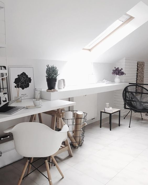 a white Scandinavian home office with a skylight feels airy, and black touches add drama