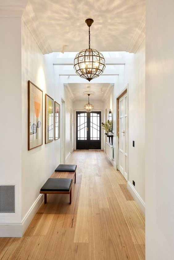 large mid-century modern framed glass pendant lamps bring so much light that two are enough for the whole hallway