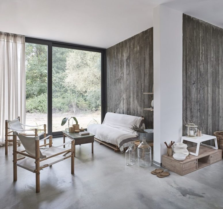 Some walls are clad with reclaimed wood, there's rattan furniture and a pallet sofa