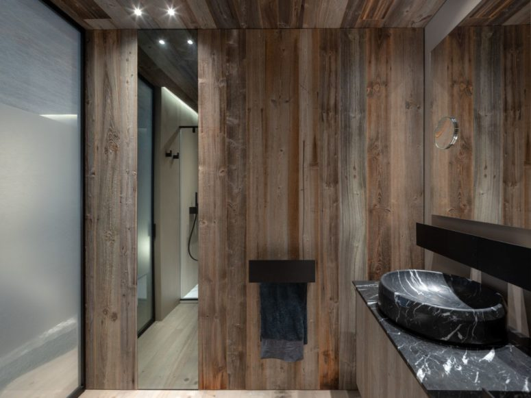 The same reclaimed wood was even used on some of the bathroom walls as a way of maintaining a cohesive look throughout the house