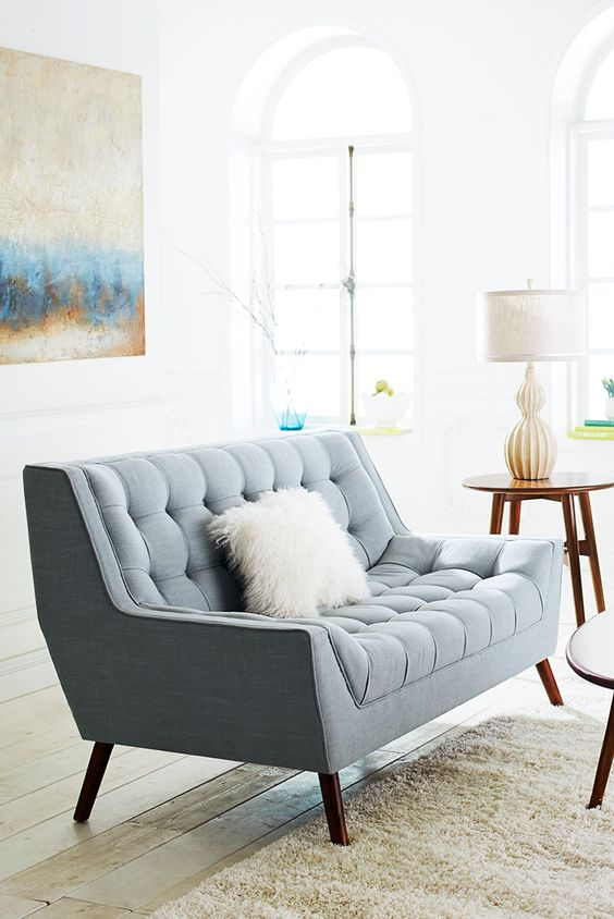 a lovely powder blue loveseat with a fluffy pillow will easily match a mid-century modern interior