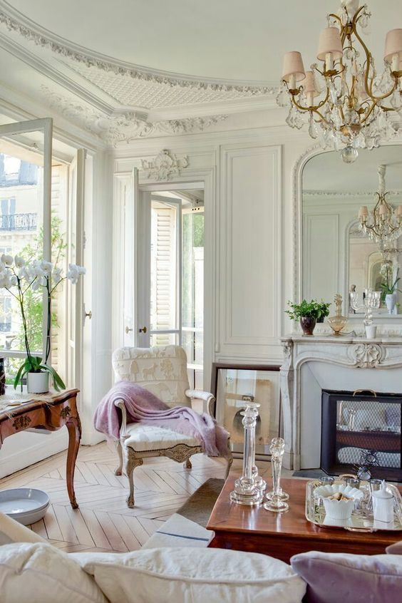 a super elegant living room with a Parisian feel and hardwood parquet floors of a neutral warm shade