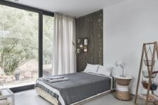 08 Here's another bedoro with a reclaimed wood wall, a bed, wall lamps, a glazed wall and wooden furniture