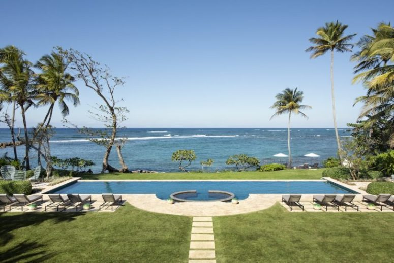 Here's another pool with a gorgeous sea view and a row of loungers