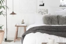 08 a neutral Scandinavian bedroom with grey accent touches and dark stained wooden furniture