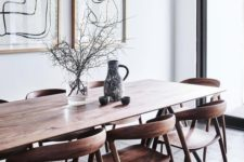 08 a sleek wooden dining table with curved wooden chairs for a contemporary dining space