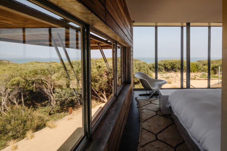 The bedrooms feature amazing views of the surroundings and are decorated in a simple and laconic way