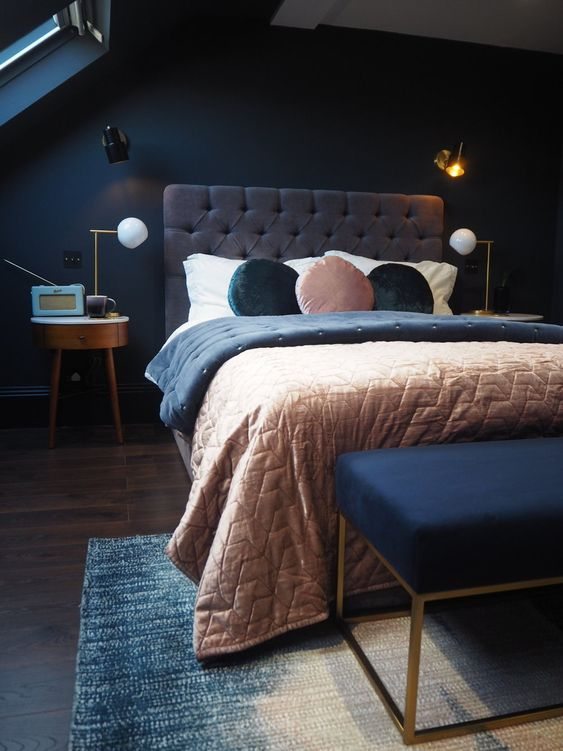a moody bedroom done with navy and greys plus soft pastel touches is a great idea for those who love sleeping in darker spaces