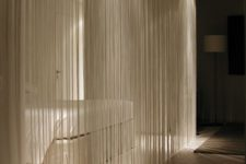 09 a white fringe curtain is a cool take on a usual white sheer curtain, it divides spaces and doesn't look obtrusive