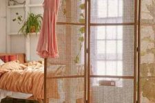 10 a foldable cane and rattan screen will subtly divide spaces and make a natural accent in your home
