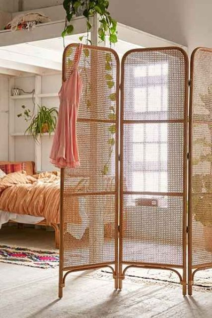 a foldable cane and rattan screen will subtly divide spaces and make a natural accent in your home