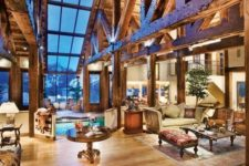 10 a large illuminated barndominium space done with large exposed beams that are supporting the roof