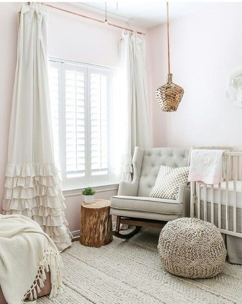 a neutral nursery featuring wicker accents and knit and crochet elements for more coziness