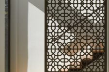 11 a sheer laser cut screen of Douglas fir is a stylish way to divide spaces and accent them a bit