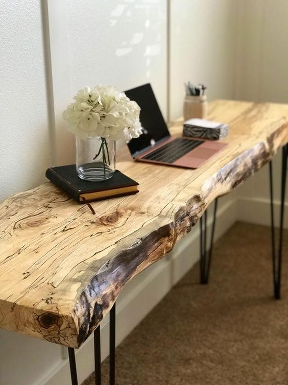 a sleek live edge desk with hairpin legs features two trends in one and can be also used as a console table