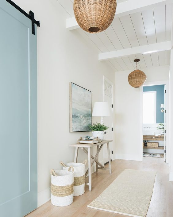 wicker pendant lamps finish off a beach hallway and make it more chic and cool