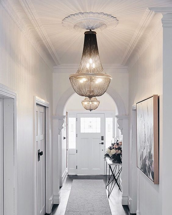 a couple of gorgeous and stylish chandeliers will add chic and charm to your entryway