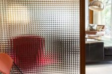 12 a glass screen is a neutral and not too bulky space divider for a small home