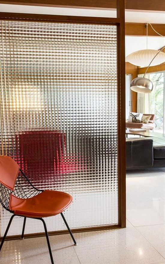 a glass screen is a neutral and not too bulky space divider for a small home