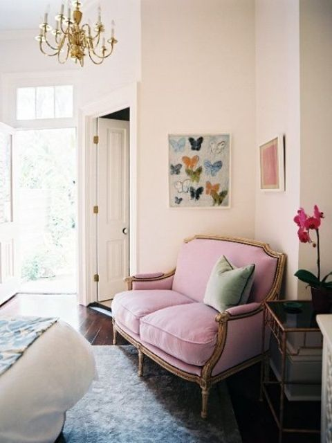 a refined pink loveseat with gold framing is a great idea to use that awkward nook in your bedroom